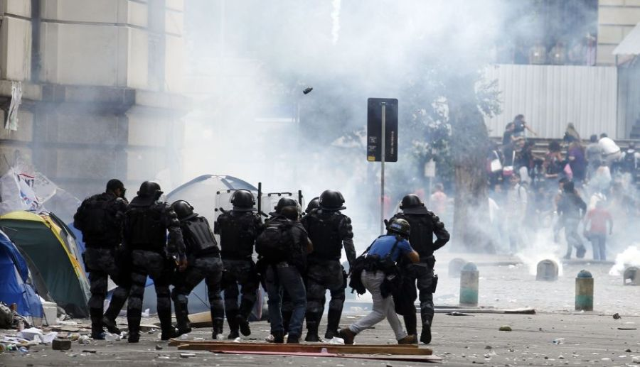 Police officers clash with demonstrators outside the Municipal Chamber during the teacher's strike in Rio de Janeiro